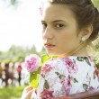 Cute teenage girl on floral dress portrait — Stock Photo
