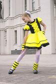 Little girl dancing in bee costume — Stock Photo