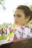 Cute teenage girl on floral dress portrait — Stock Photo