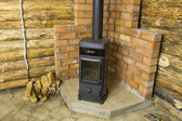 Old-fashioned Potbelly stove in wooden house — Stock Photo