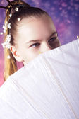 Young teenage girl in floral kimono in studio — Stock Photo