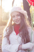 Young girl walking in the autumn park — Stock Photo