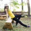 Young nice girl posing in the forest — Stock Photo #37918625