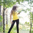 Young nice girl posing in the forest — Stock Photo #37918879
