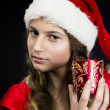 Cute teen girl in santa claus costume — Stock Photo