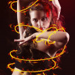 Stock Photo: Young girl dancing with fire