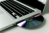 Loading software into a laptop — Stock Photo