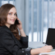 Pretty business woman at office desk. — Stock Photo