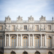 Palace with statues on top in Versailles — Stock Photo