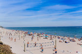 Colorful beach with people and umbrellas. — Stock Photo