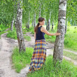 Young woman near birch tree — Stock Photo