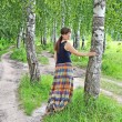 Young woman near birch tree — Stock Photo #12409770