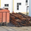 Freight train and pipe stack — Stock Photo