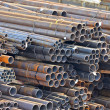 Stacked steel pipe - Stock Photo