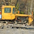 Bulldozer on road construction site — Stockfoto
