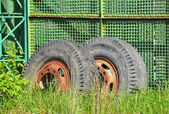 Old industrial truck wheel on wasteland — Stock Photo