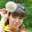 Young woman with large dandelion — Stock Photo