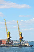 Tugboat and freight train under port crane — Stock Photo