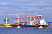 Cargo crane, tugboat and ship — Stock Photo