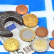 Earning in Greece concept with money and wrench — Photo