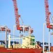 Cargo crane and ship - Stock Photo