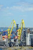 Cargo crane and grain dryer — Stock Photo