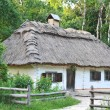 Foto de Stock  : Ancient hut with straw roof