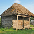 Ancient barn with a straw roof — Stock Photo #27296339