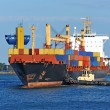 Tugboat assisting container cargo ship — Stock Photo #32280739
