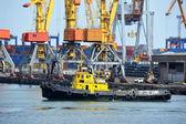 Tugboat and port cargo crane — Stock Photo