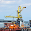 Bunker ship (fuel replenishment tanker) under port crane — Stock Photo