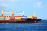 Container stack on freight ship — Stock Photo