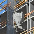 Crane lifting cement mixing container — Stockfoto