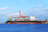 Cargo crane and ship — Stockfoto