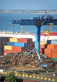 Scrap metal, container and pipe in port — 图库照片