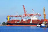 Cargo crane and ship — Stok fotoğraf