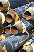 Rusty steel pipe with heat insulation — Stock Photo