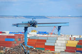 Scrap metal and container in port — Stock Photo