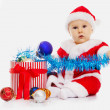 The boy in an image of Santa Claus sits — Stock Photo