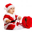 Small Santa with red bag for gifts near him — Stock Photo