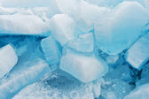 Blocks of pure ice in sunlight for background — Stock Photo