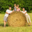 Stock Photo: The family outdoors has rest on hay