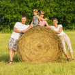 The family outdoors has rest on hay — Stock Photo