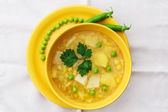 Meatless soup in round yellow cup. — Stock Photo