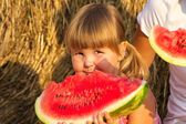 Girl eats red tasty water-melon — Stock Photo