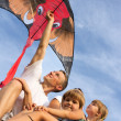 The family outdoors flying kite in the sky — Stock Photo