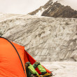 The climber has a rest lying in tent on glacier — Stock Photo