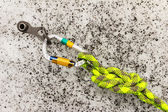 Carbine and hook with rope in ice — Stock Photo