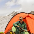 The climber in tent against Mountains Altai — Stock Photo #21061195