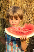 The small child outdoors eats water-melon — Stock Photo
